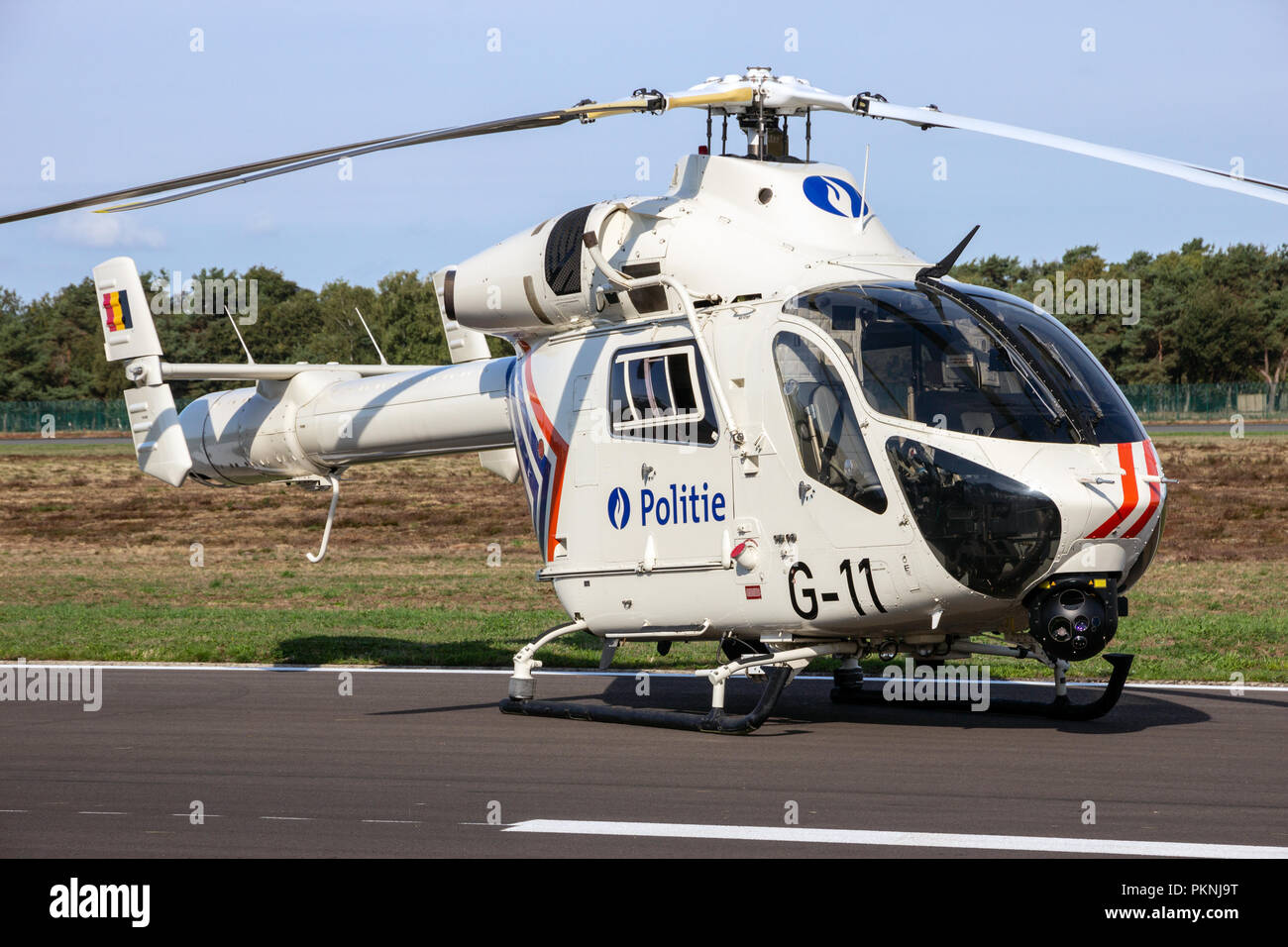 KLEINE BROGEL, BELGIUM - SEP 8, 2018: MD 902 Explorer helicopter from the Belgian Federal Police on the tarmac of Kleine-Brogel Airbase. Stock Photo