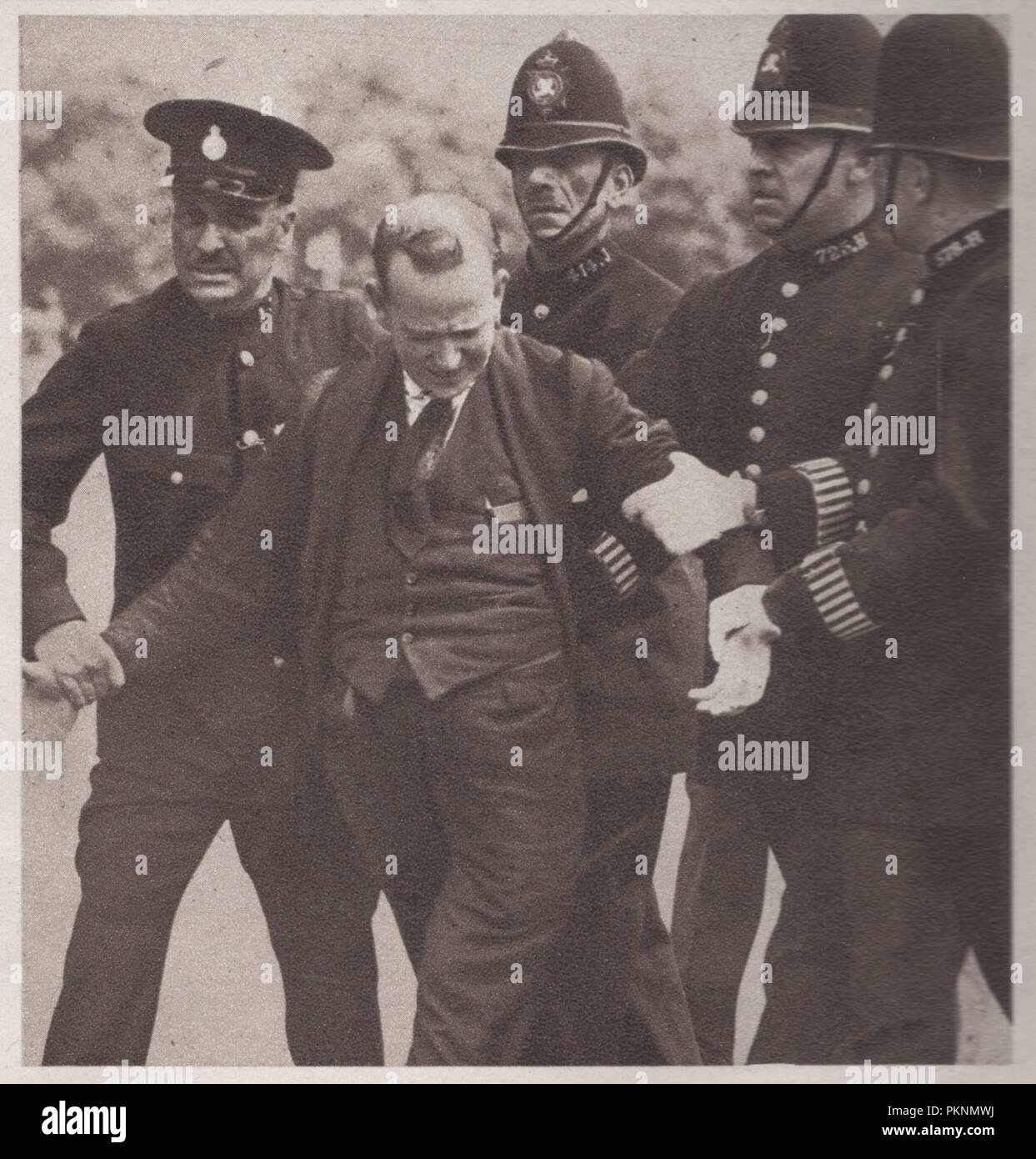 Irishman George Andrew Campbell McMahon also known as Jerome Bannigan being arrested by the police on Constitution Hill during the trooping the colour ceremony on 16 July 1936 where he drew a revolver and threw it at King Edward VIII as he rode past.  He was sentenced to 12 months imprisonment and hard labor on 14 September 1936.  He said that he was protesting the failure of authorities to respond to McMahon's reports of a plot to kill the king. He also claimed to have been working with the Security Services. - Stock Image
