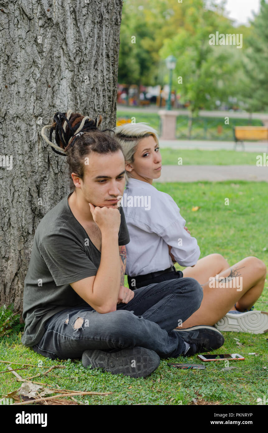 Relationship difficulties: Young couple having a problems.They are upset with each other. - Stock Image