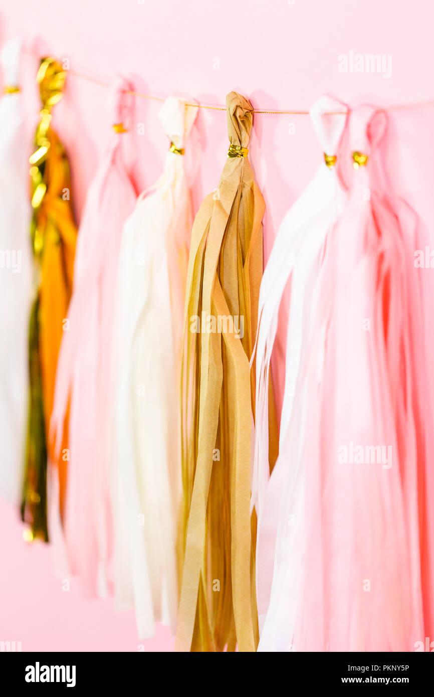 Paper Tassel Garland On A Pink Wall At The Kids Birthday Party Stock Photo Alamy