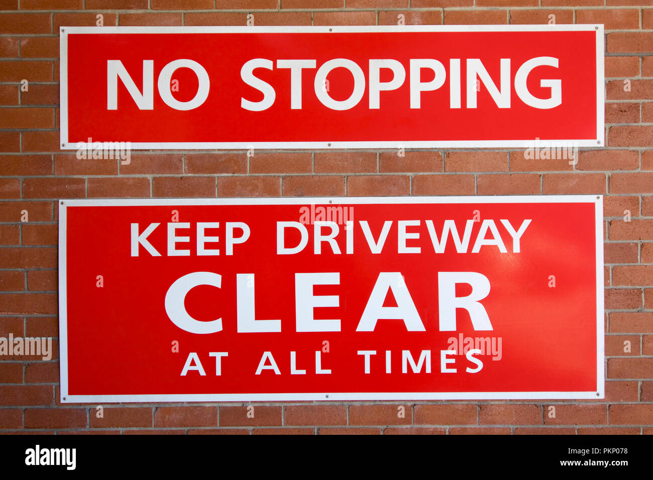 No Stopping Keep Driveway Clear at all Times sign. - Stock Image