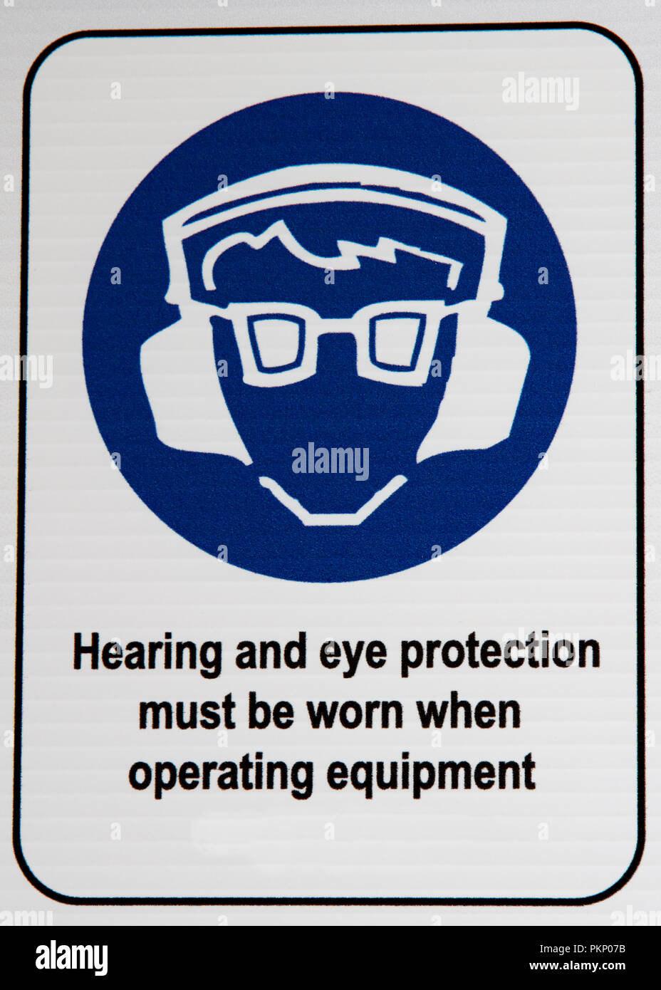 Hearing and Eye Protection sign at a construction site. - Stock Image