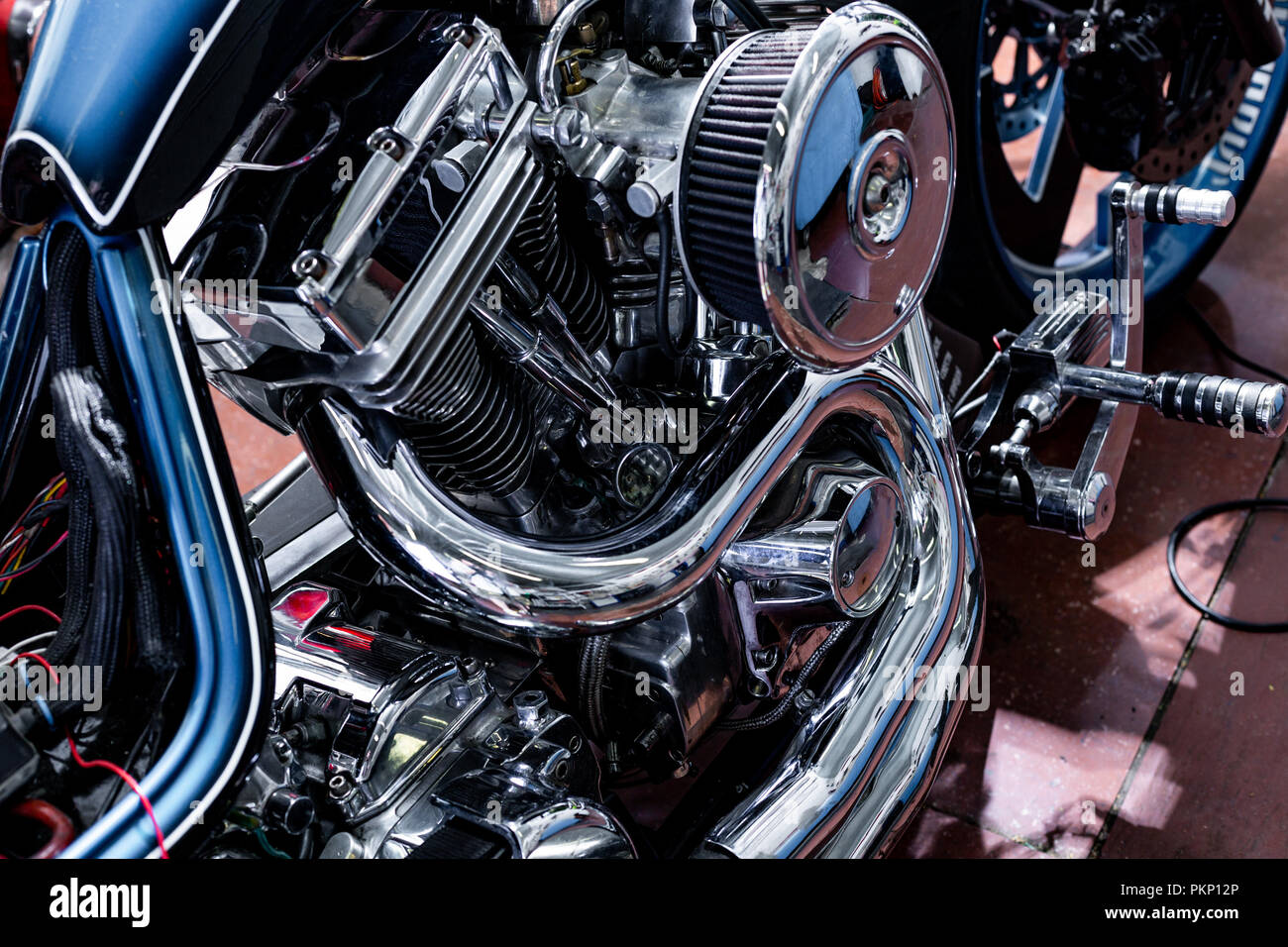 Engine close up shot of beautiful and custom made motorcycle - Stock Image
