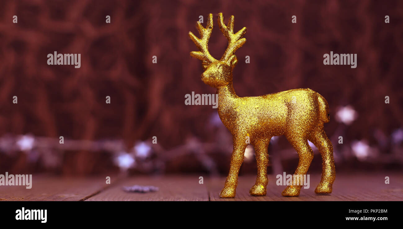 Christmas or New Year golden Reindeer banner background with lights and copy space - Stock Image