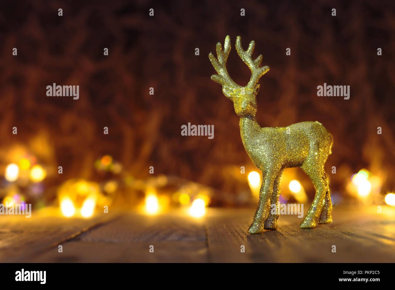 Christmas or New Year golden Reindeer background with lights and copy space - Stock Image