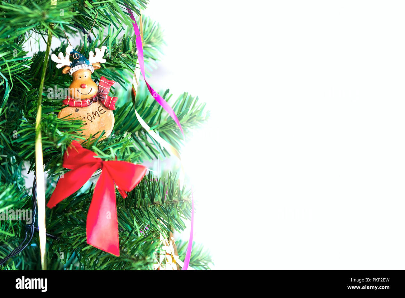 Christmas or New Year background with green christmas tree branch, decorations with copy space - Stock Image
