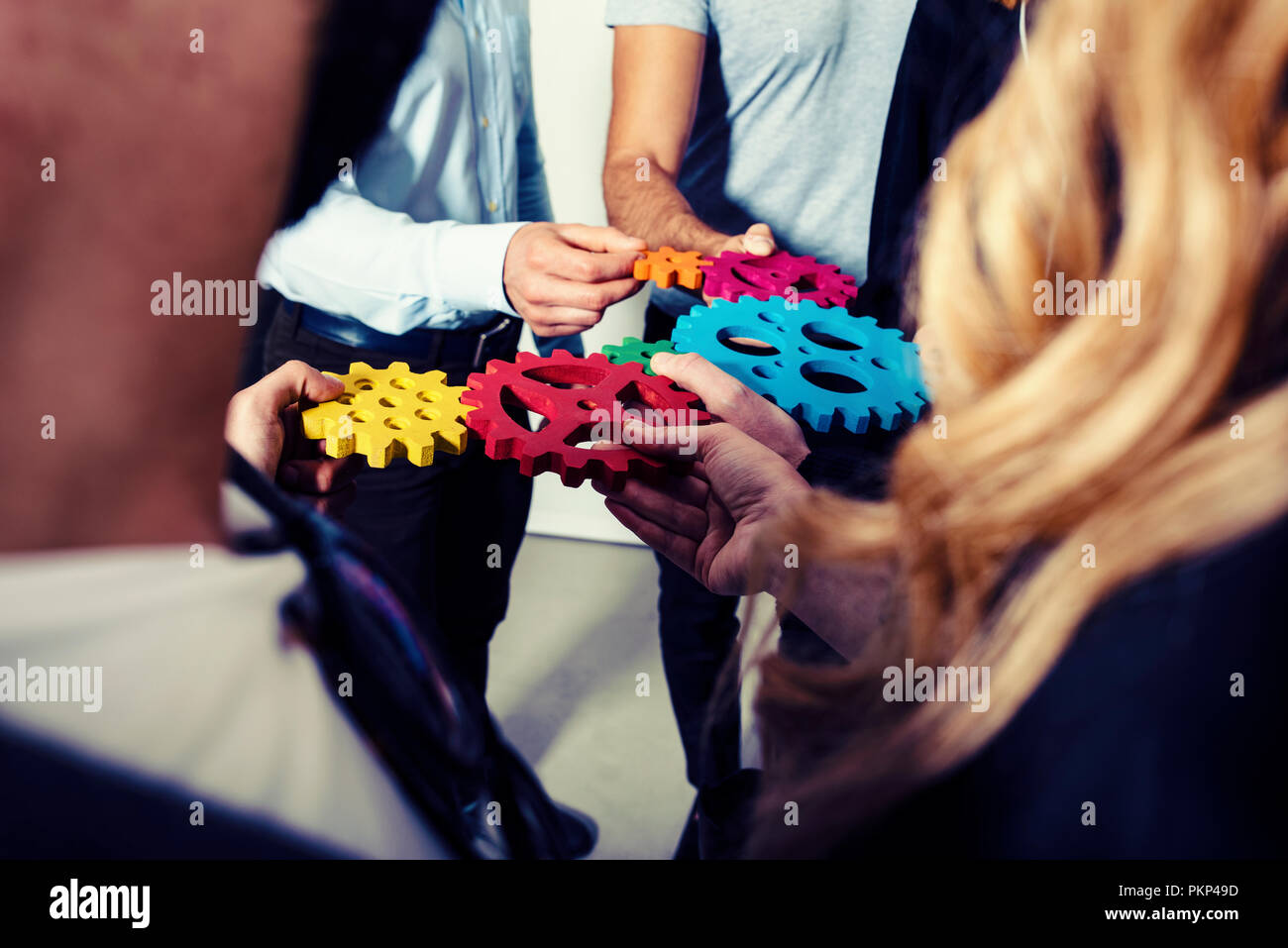 Business team connect pieces of gears. Teamwork, partnership and integration concept - Stock Image