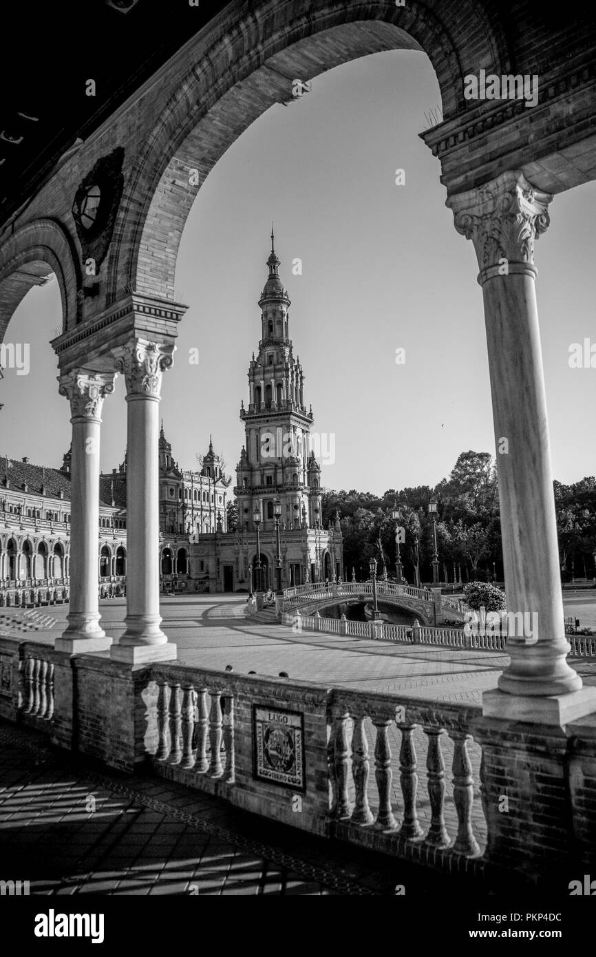Seville, Spain- June 18, 2017 : People walk in the courtyard of the plaza de Espana in Seville, Spain June 2017 on a hot summer day. - Stock Image