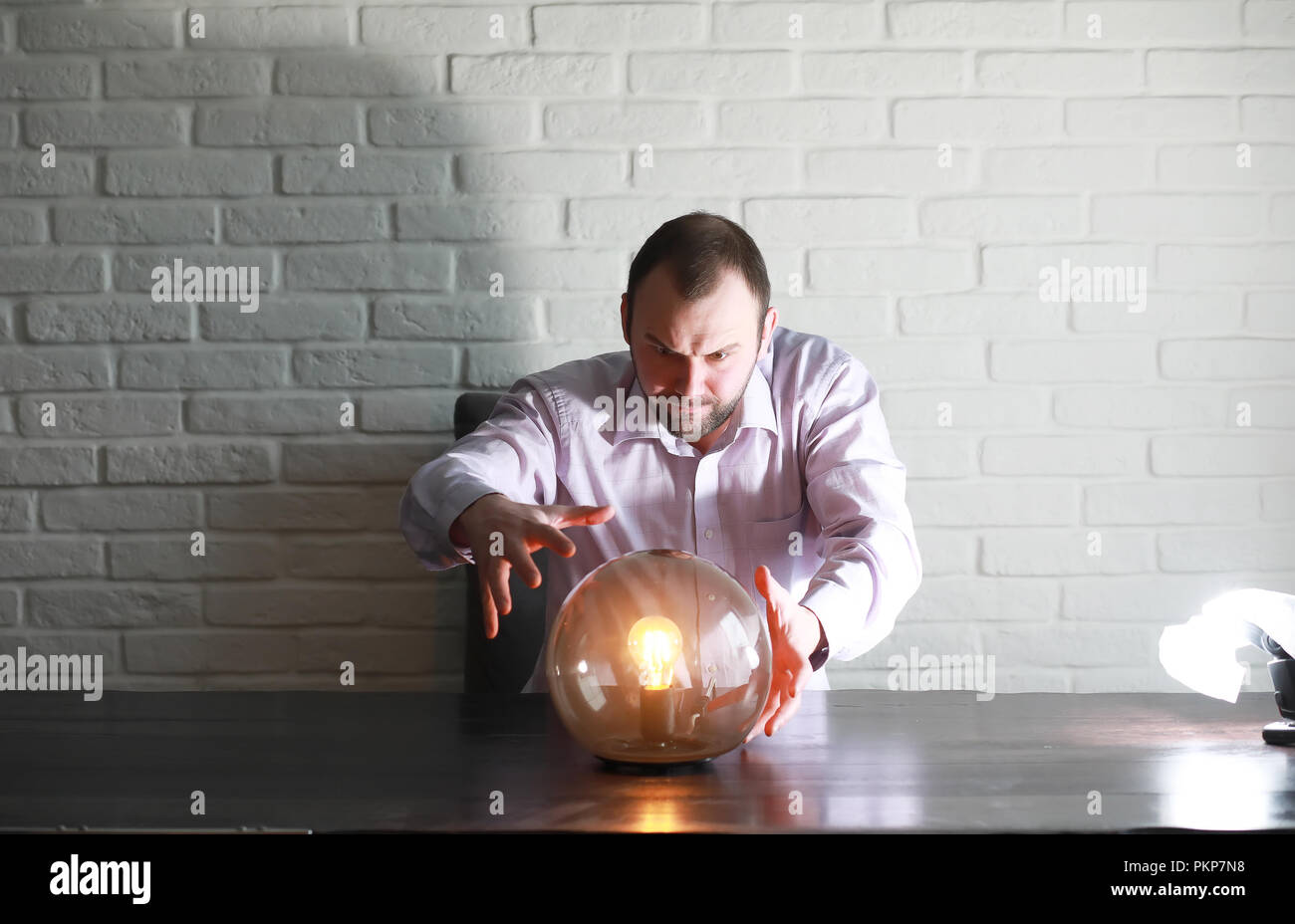 A man with a fortune teller ball - Stock Image