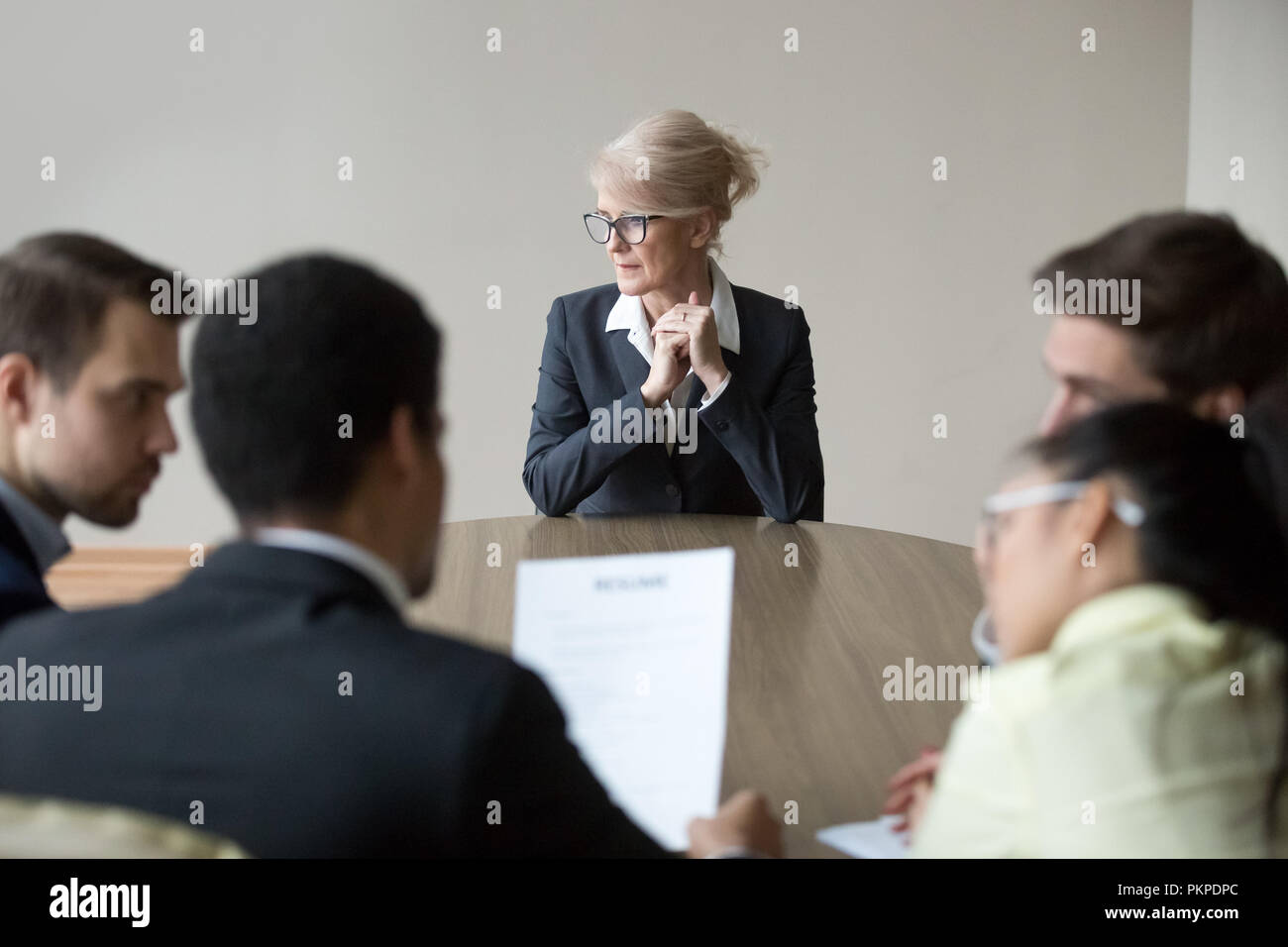 Woman passing job interview in the office at boardroom - Stock Image
