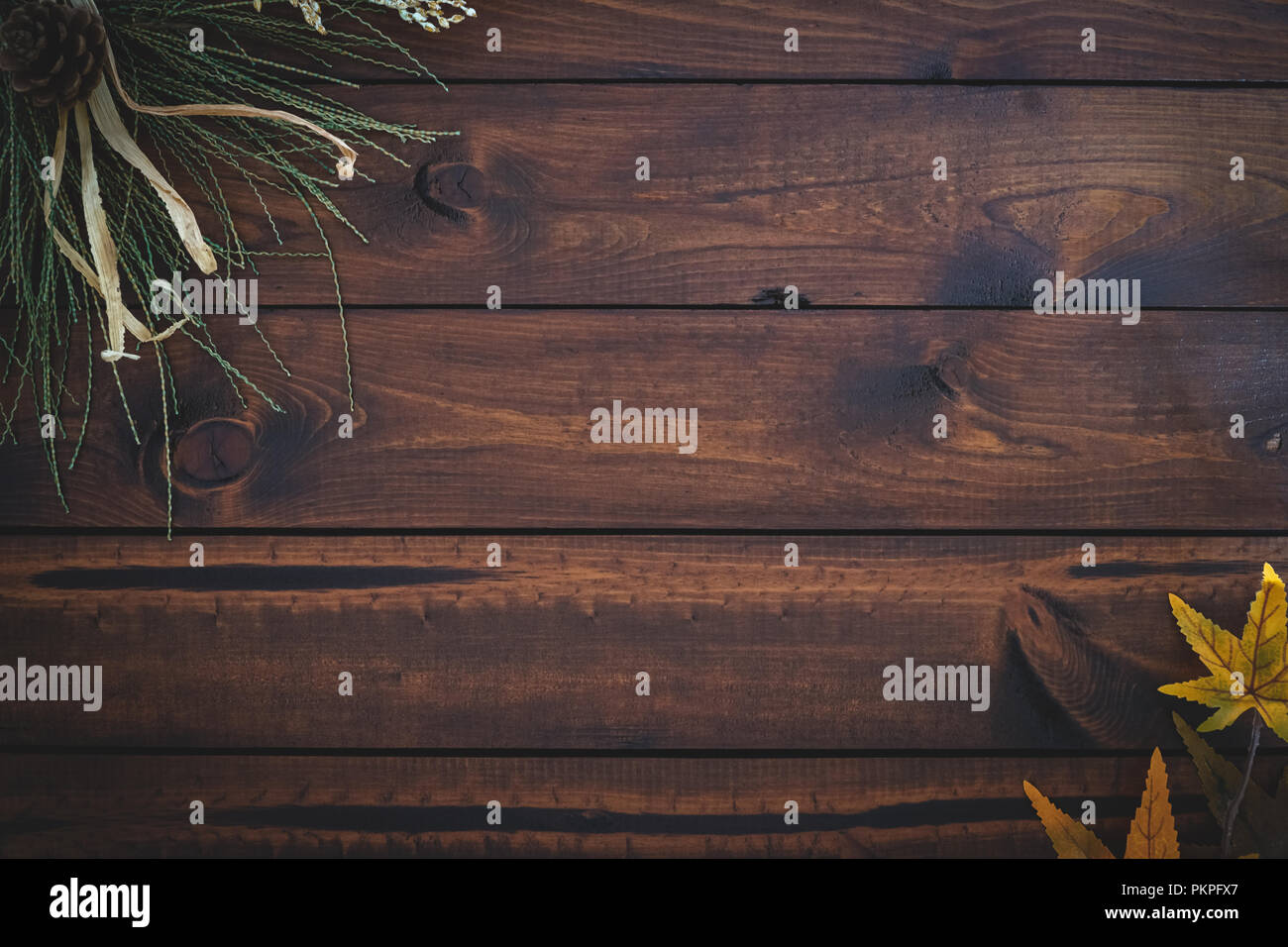 Autumn leaves over wooden background with copy space - Stock Image
