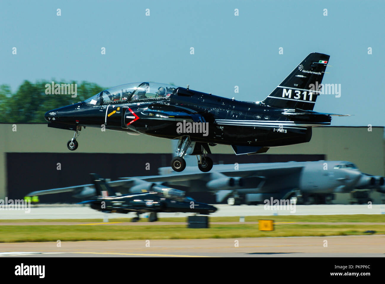 Alenia Aermacchi, subsidiary of Leonardo (formerly Finmeccanica) M311 jet trainer I-PATS. M-311 became M-345. Landing at RAF Fairford with B-52 beyond - Stock Image