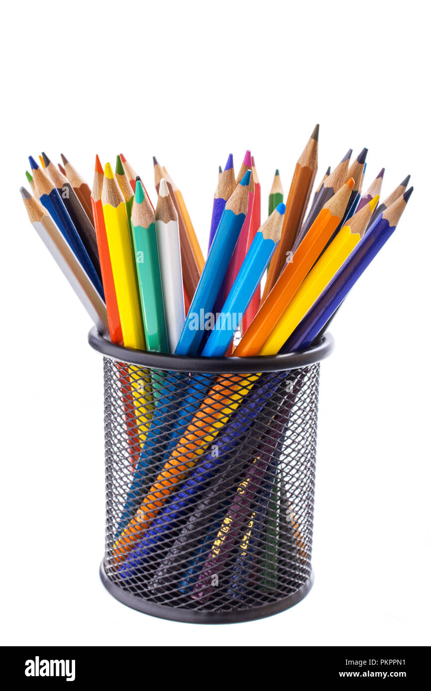 colored pencils in a metal stand - Stock Image
