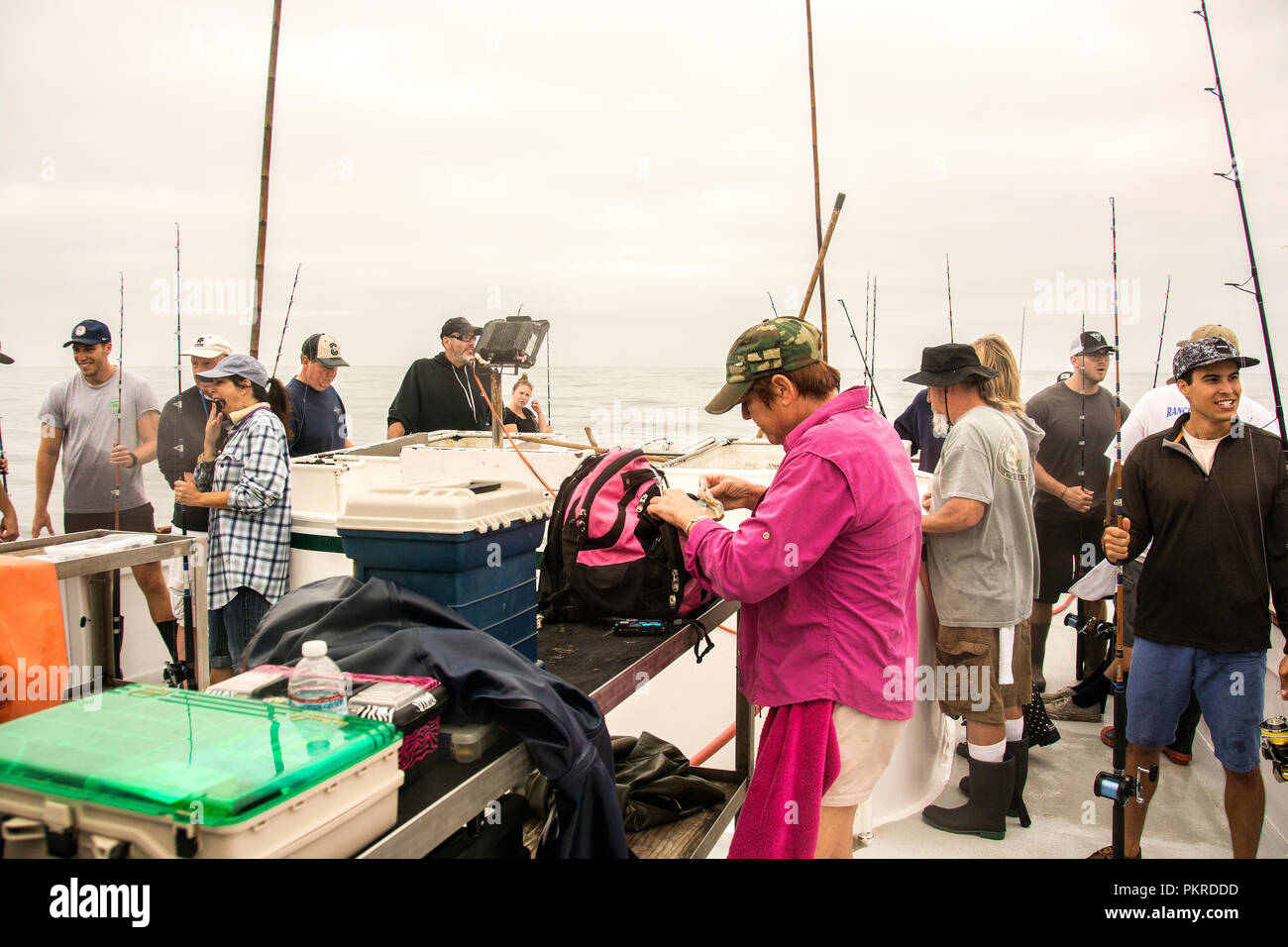 A large group of fishermen in the midst of fishing and catching fish - Stock Image