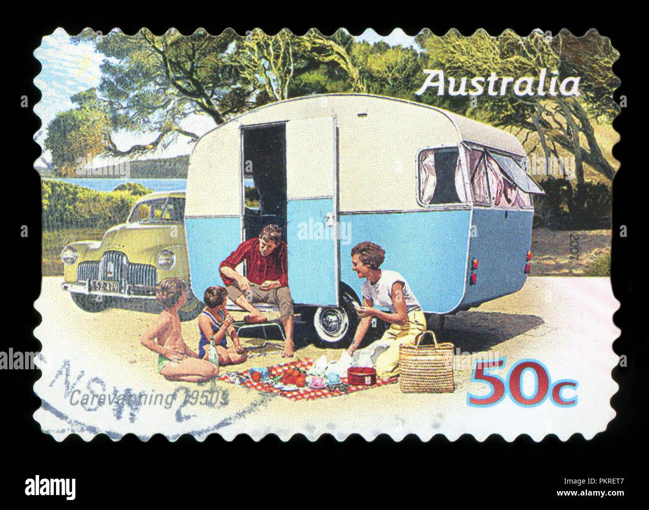 AUSTRALIA - CIRCA 2007: A stamp printed in australia shows Family enjoying a caravan of the 50s, caravanning 1950s, circa 2007 - Stock Image
