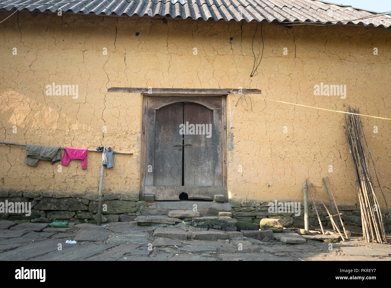 Small House Of Ethnic Minority People There Is Wall Made Of Clay In