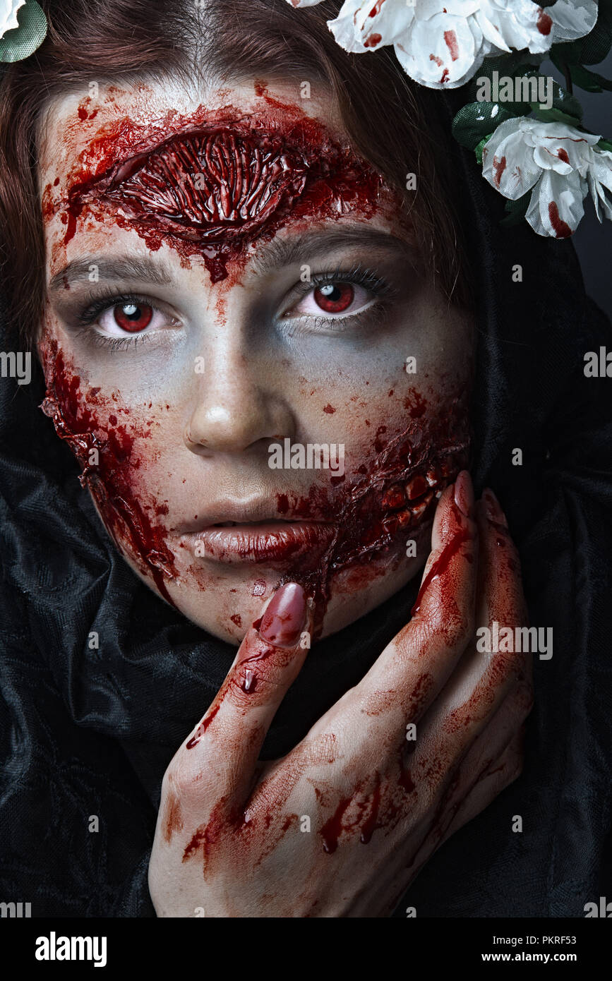 Portrait Of Bloody Horrible Scary Zombie Girl In A Halloween Festive