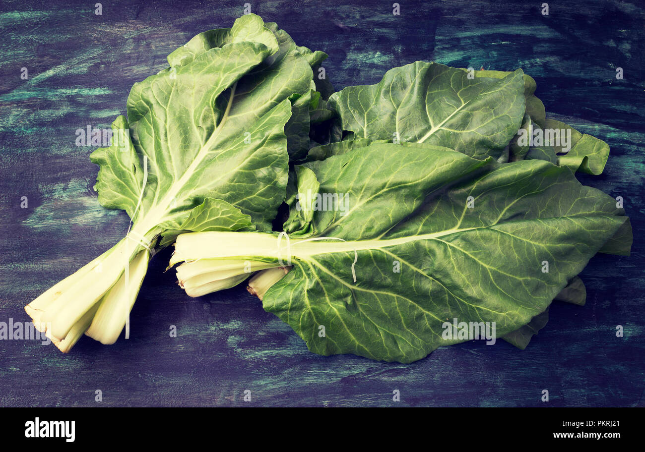 Bunch of organic mangold  on a rustic wooden background - Stock Image