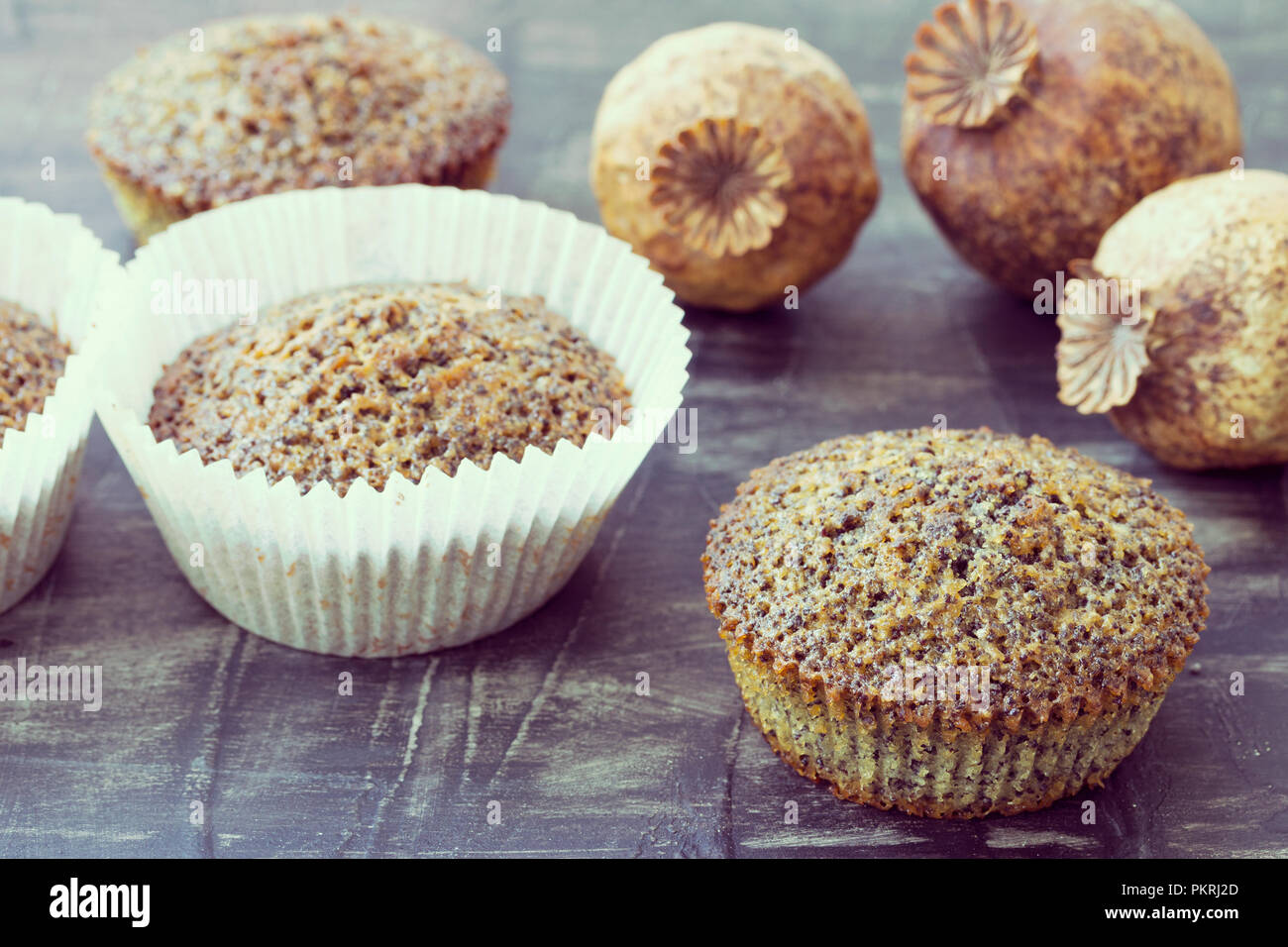 Fresh homemade muffins with poppy seeds - Stock Image