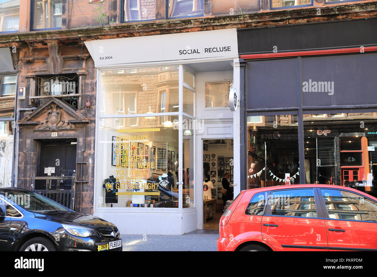 Trendy shops on bohemian King Street, in Glasgow's Merchant City, in Scotland, UK - Stock Image
