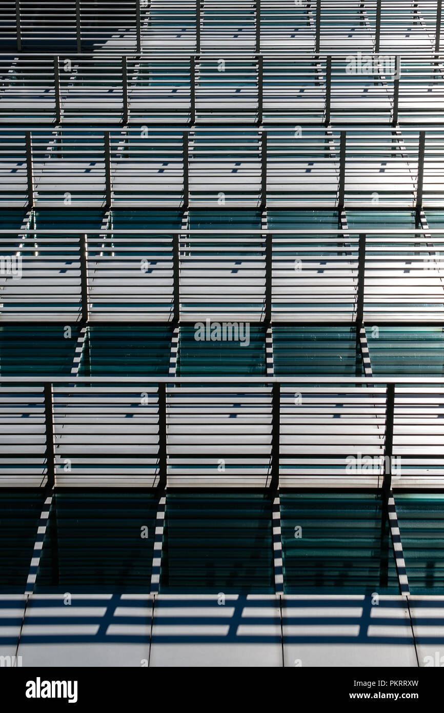 Abstract Of Sun Screens And Shadows On A Building - Stock Image