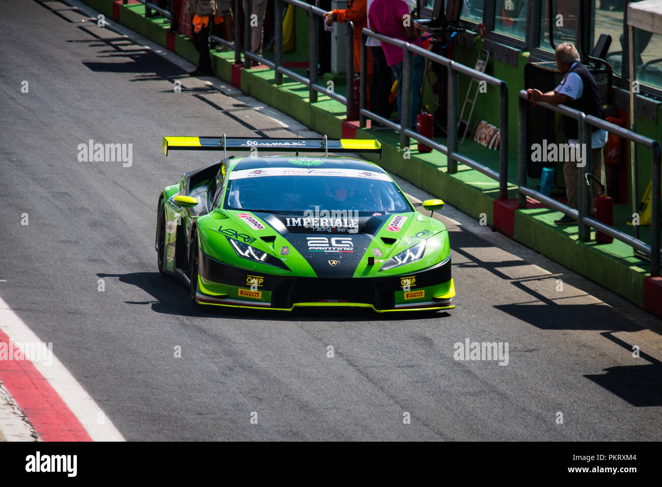 High angle view full length of Lamborghini touring car in racing circuit pit lane - Stock Image