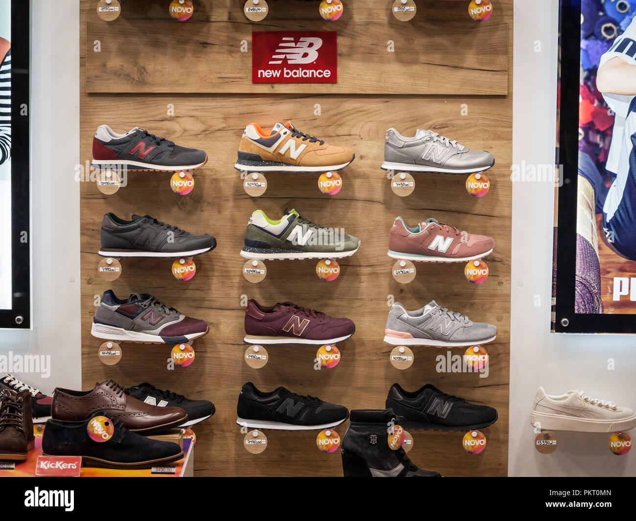 BELGRADE, SERBIA - SEPTEMBER 2, 2018: New Balance logo and sneakers on display in the window of their main retailer in Belgrade. New Balance is an Ame - Stock Image