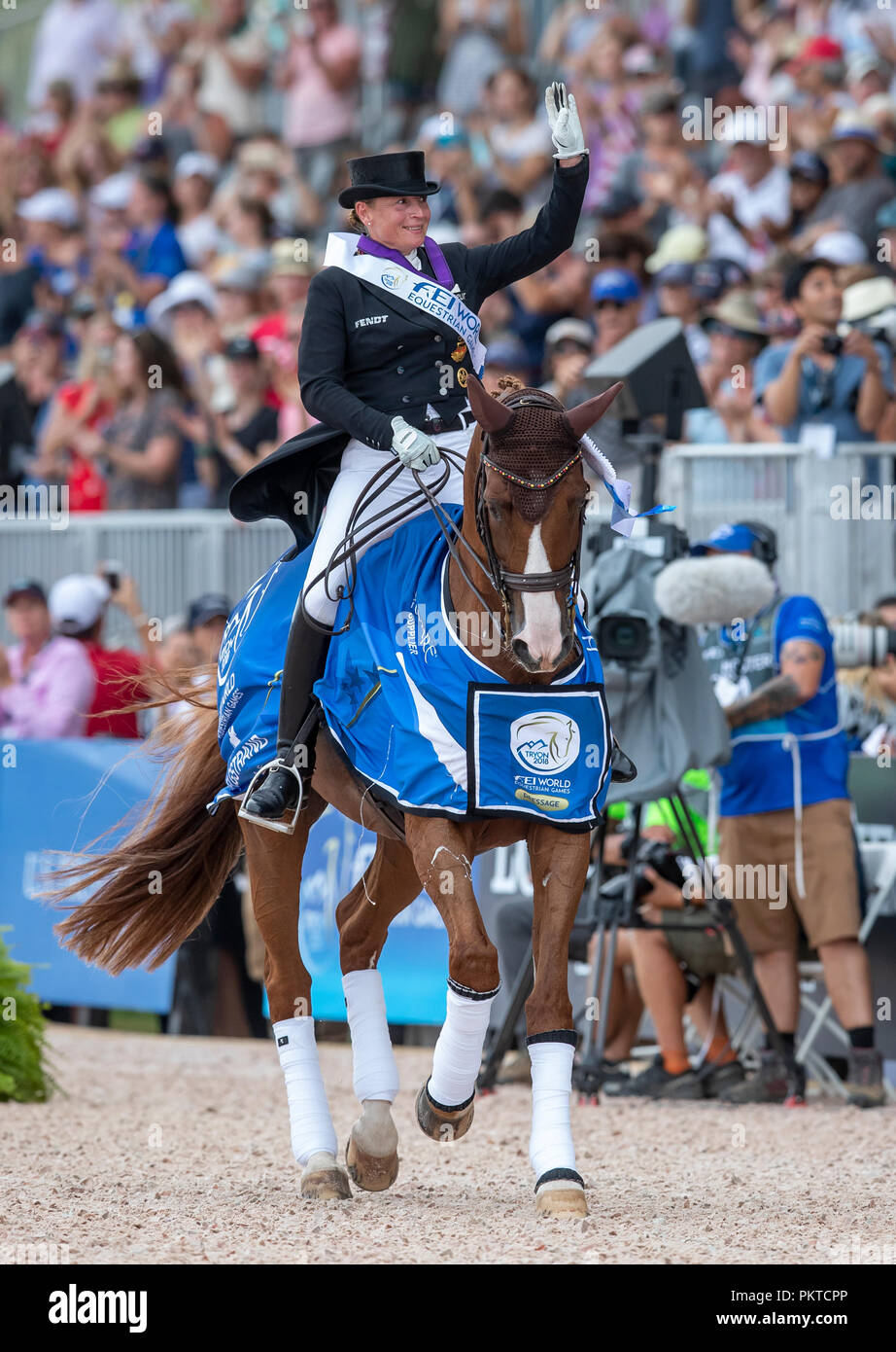 Tryon, USA. 14th Sep, 2018. Riding, FEI World Equestrian Game 2018, Grand Prix Special: Isabell Werth from Germany celebrates her victory at Bella Rose. Credit: Stefan Lafrentz/dpa/Alamy Live News - Stock Image