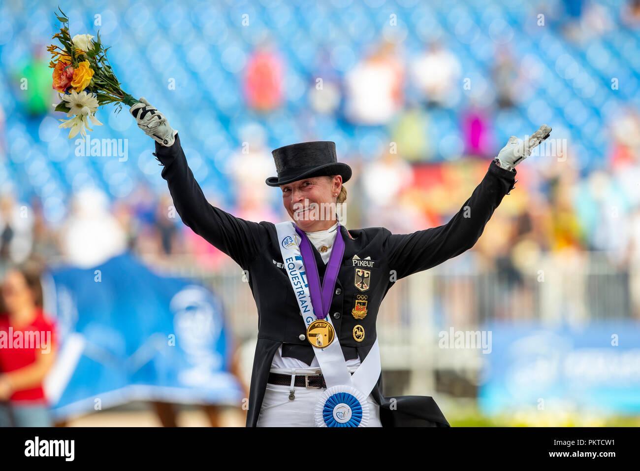 Tryon, USA. 14th Sep, 2018. Riding, FEI World Equestrian Game 2018, Grand Prix Special: Isabell Werth celebrates her victory on the podium. Credit: Stefan Lafrentz/dpa/Alamy Live News - Stock Image