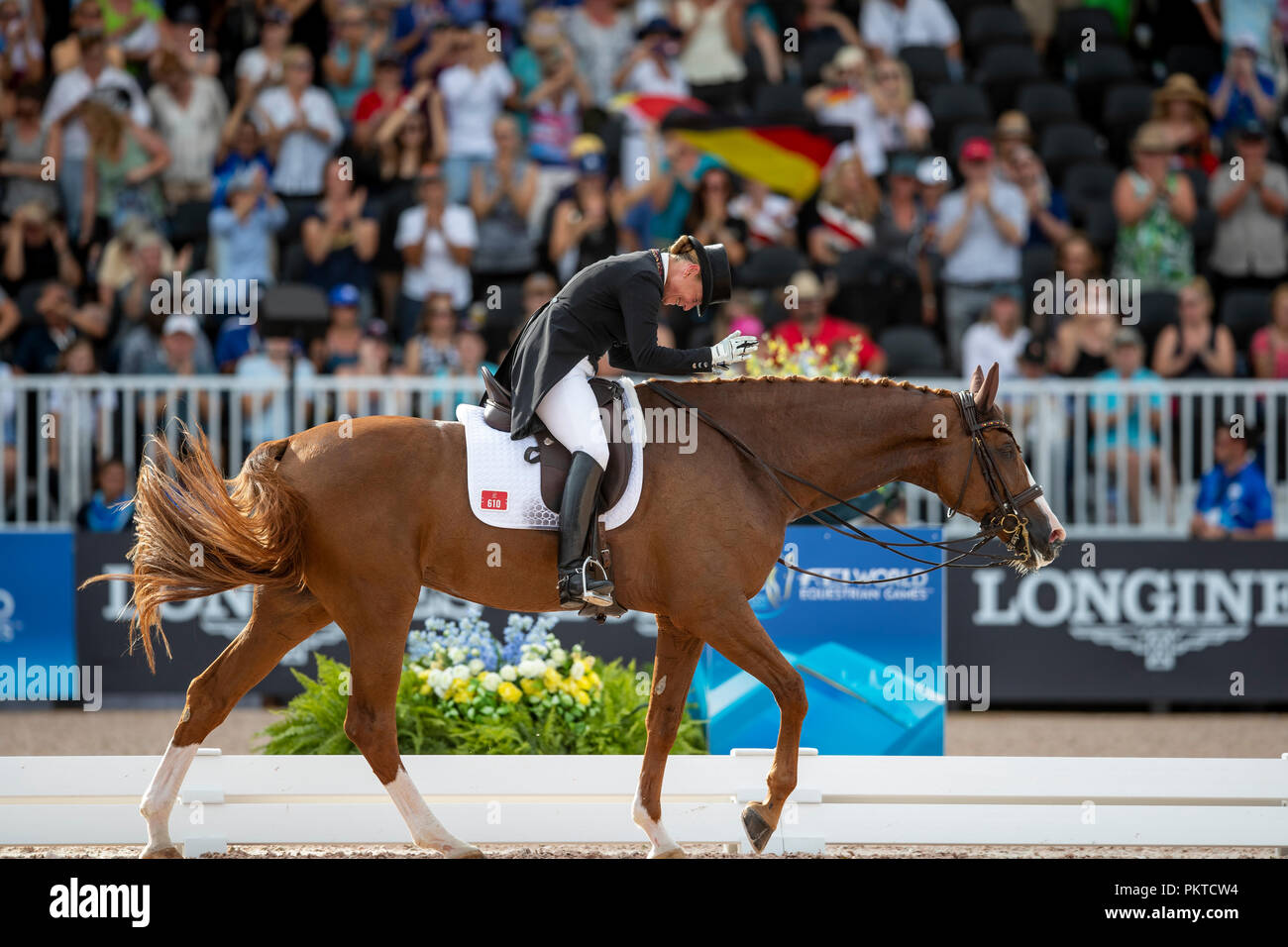 Tryon, USA. 14th Sep, 2018. Riding, FEI World Equestrian Game 2018, Grand Prix Special: Isabell Werth celebrates her victory at Bella Rose. Credit: Stefan Lafrentz/dpa/Alamy Live News - Stock Image