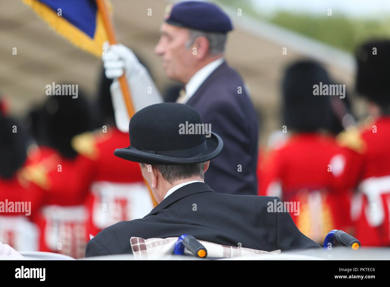 Worcester, Worcestershire, UK. 15th September 2018. An ex-serviceman wears a bowler hat at the Drumhead Service at Gheluvelt Park, Worcester. Peter Lopeman/Alamy Live News - Stock Image