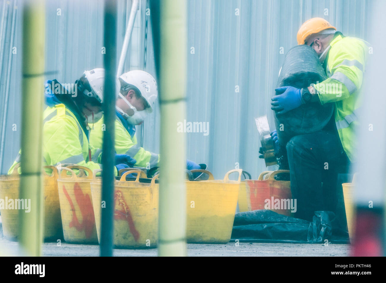Aberystwyth Wales UK, Saturday 15 September 2018  Police CSI (Crime Scene Investigation) officers sift through buckets of  charred rubble looking for forensic evidence after the discovery of human remains in the ruins  of the Ty Belgrave House hotel that was totally destroyed in a devastating fire on 25th July 2018,   30-year-old Damion Harris has been  remanded in custody at Swansea Crown Court charged with arson with intent to endanger life.   photo © Keith Morris / Alamy Live News - Stock Image