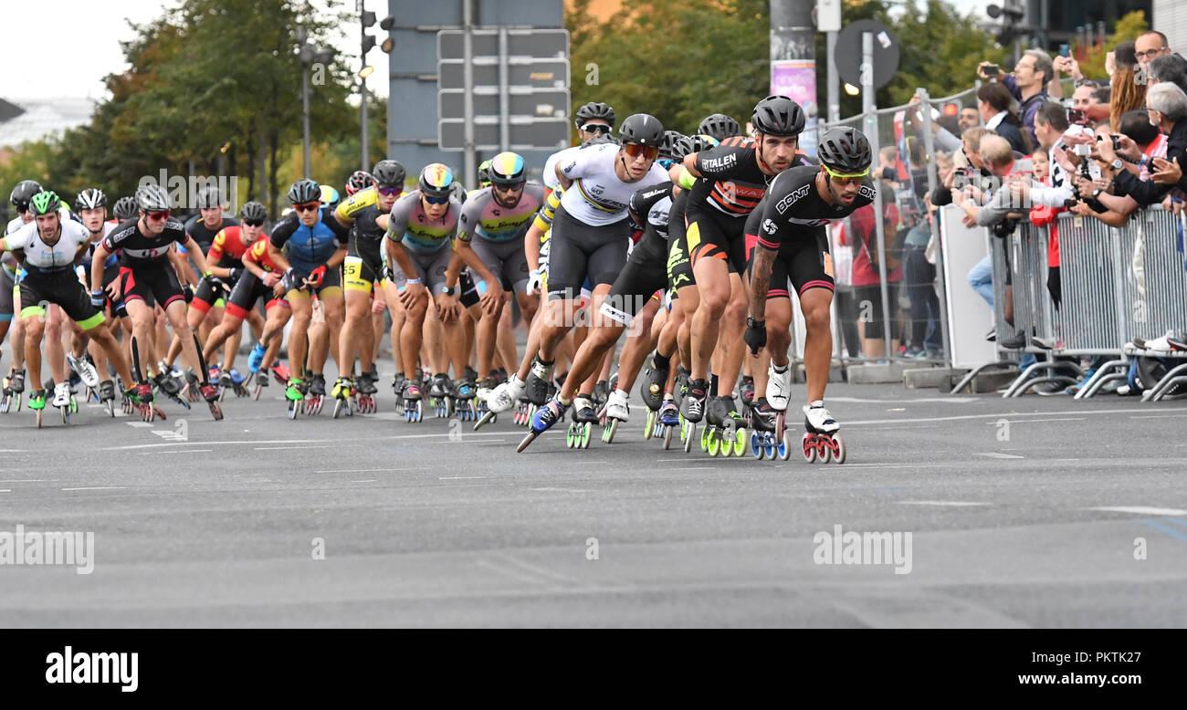 15 September 2018, Berlin: 15 September 2018, Germany, Berlin: People on inliners cross Potsdamer Platz at the 45th Berlin Marathon. Photo: Soeren Stache/dpa - Stock Image