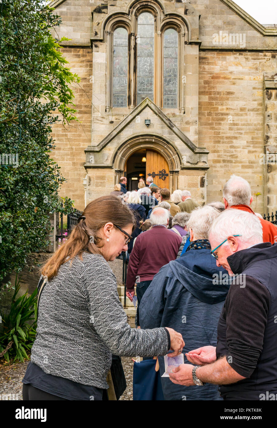 Gladsmuir Parish Church, Gladsmuir, East Lothian, Scotland, UK, 15th September 2018. The concert series continues on its second day with Bach's Musical Offering  by Dunedin Consort at the Lammermuir Festival in Gladsmuir. The 2018 Lammermuir Festival runs from 14th to 23rd September, and won the Royal Philharmonic Society Music Award in 2017. The Festival will celebrate its 10th anniversary in 2019. People queue to get into the concert and buy programmes Stock Photo
