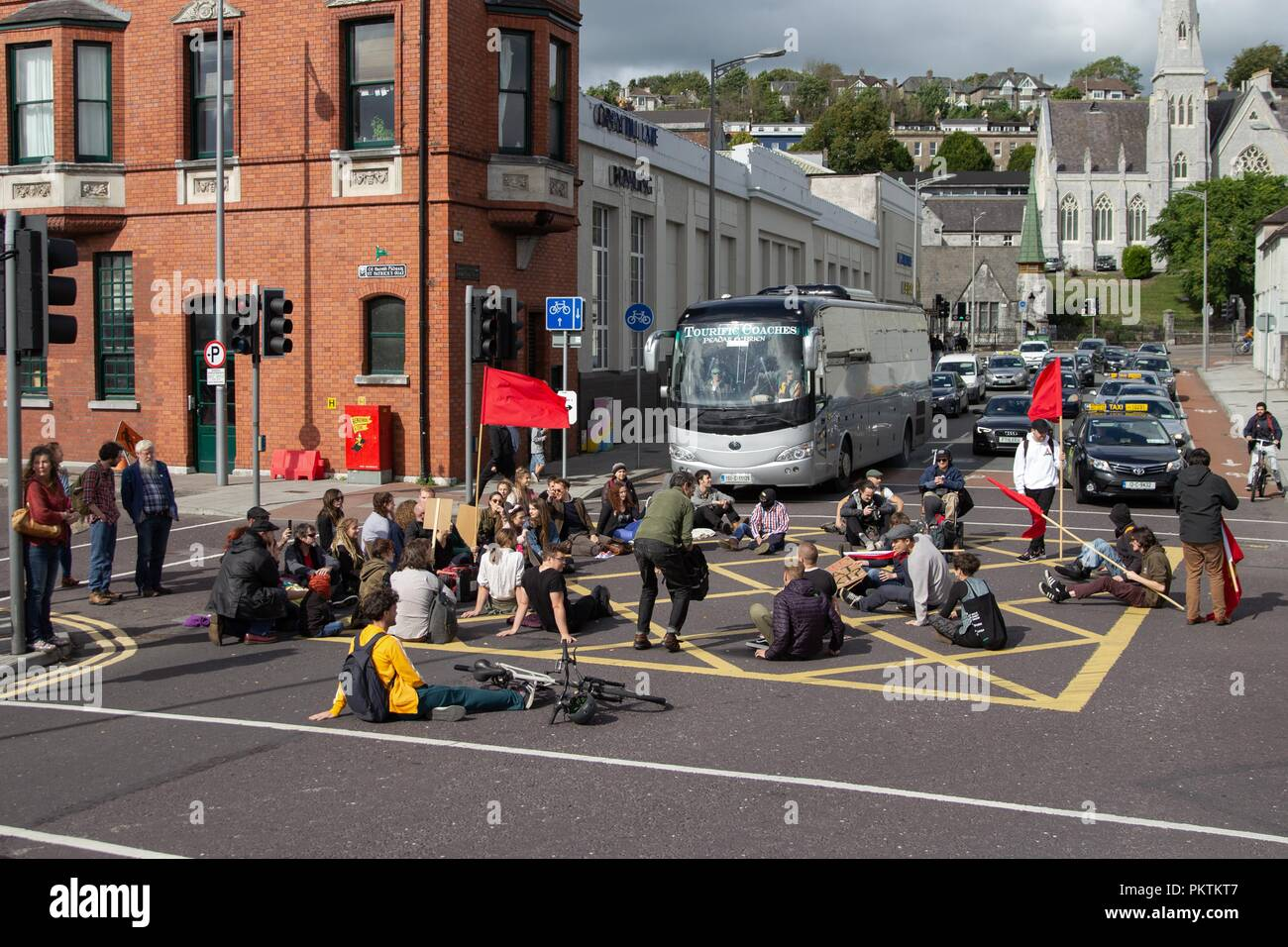 Cork, Ireland. 15th Sept, 2018. Sit-In by Connelly Youth Movement, Cork City. Today at 2:30 The Connonelly Youth Movement staged a protest on the Brian Bru Bridge which brought traffic to a standstill. This sit in was staged to protest the eviction of the people of 'Tentsville' located on Patricks Quay. Credit: Damian Coleman/Alamy Live News. - Stock Image