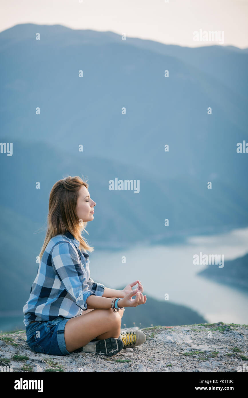 Young woman doing yoga in nature Stock Photo