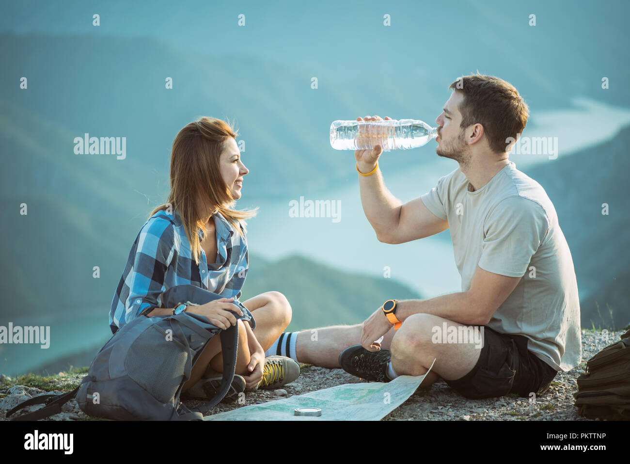Hiking couple with map Stock Photo