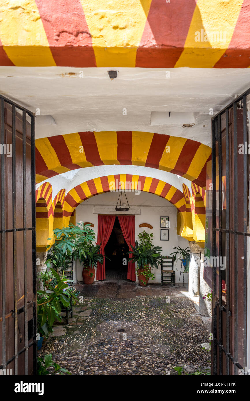 Cordoba Spain June 20 2017 Yellow Arches At Entrance To A Restaurant With Red Curtains In Cordoba Spain Europe Andalucia Stock Photo Alamy