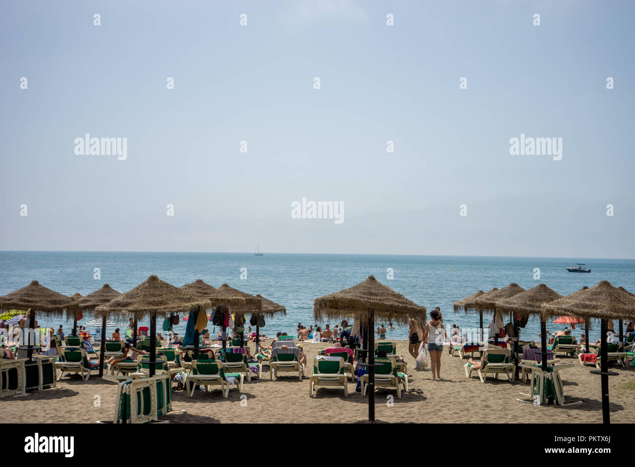 Malaga, Spain - June 24: The beach with huts at Malaga, Spain. This beach was part of the land reclaimed from the Malaga sea Stock Photo