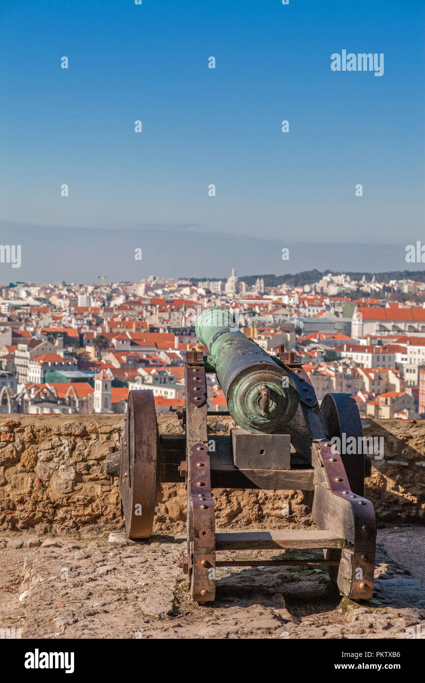 Lisbon, Portugal. Old bronze cannon in Sao Jorge aka Saint George Castle and a view of Lisbon Baixa District rooftops. - Stock Image