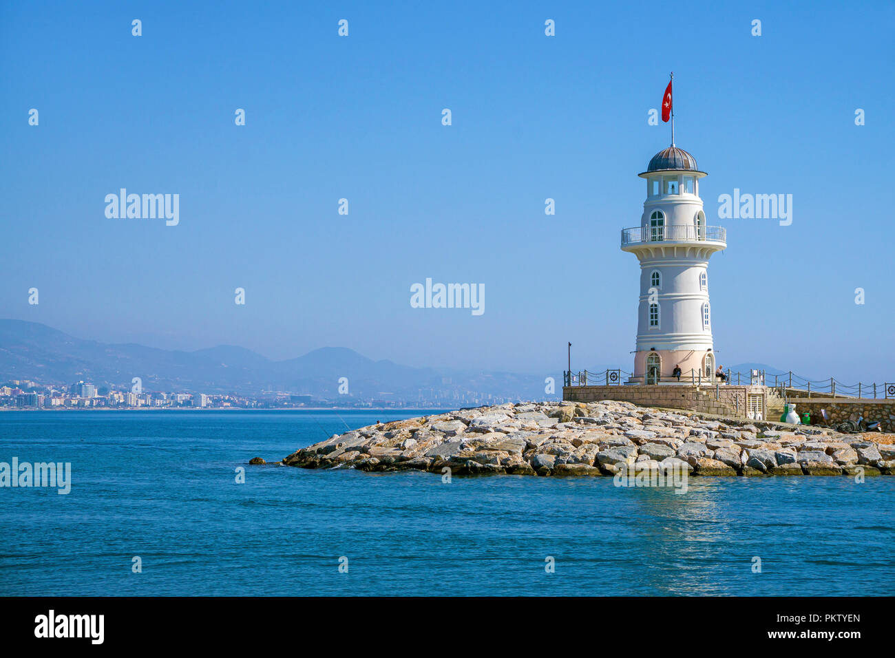 Lighthouse at the harbor entrance of Alanya, seaside resort on the Turkish Riviera, Turkey - Stock Image