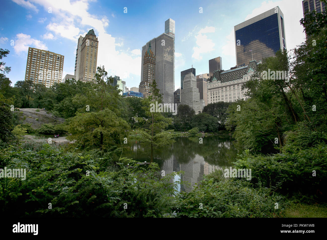 View on skyscrapers from Gapstow Bridge in Central Park, New York, USA - Stock Image