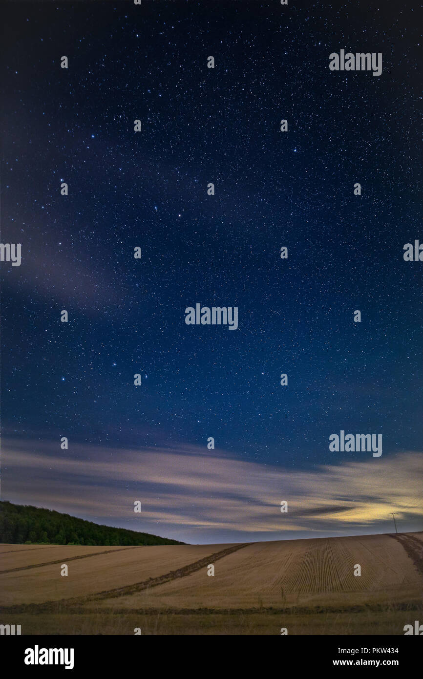 Night Sky With Stars over Field - Stock Image