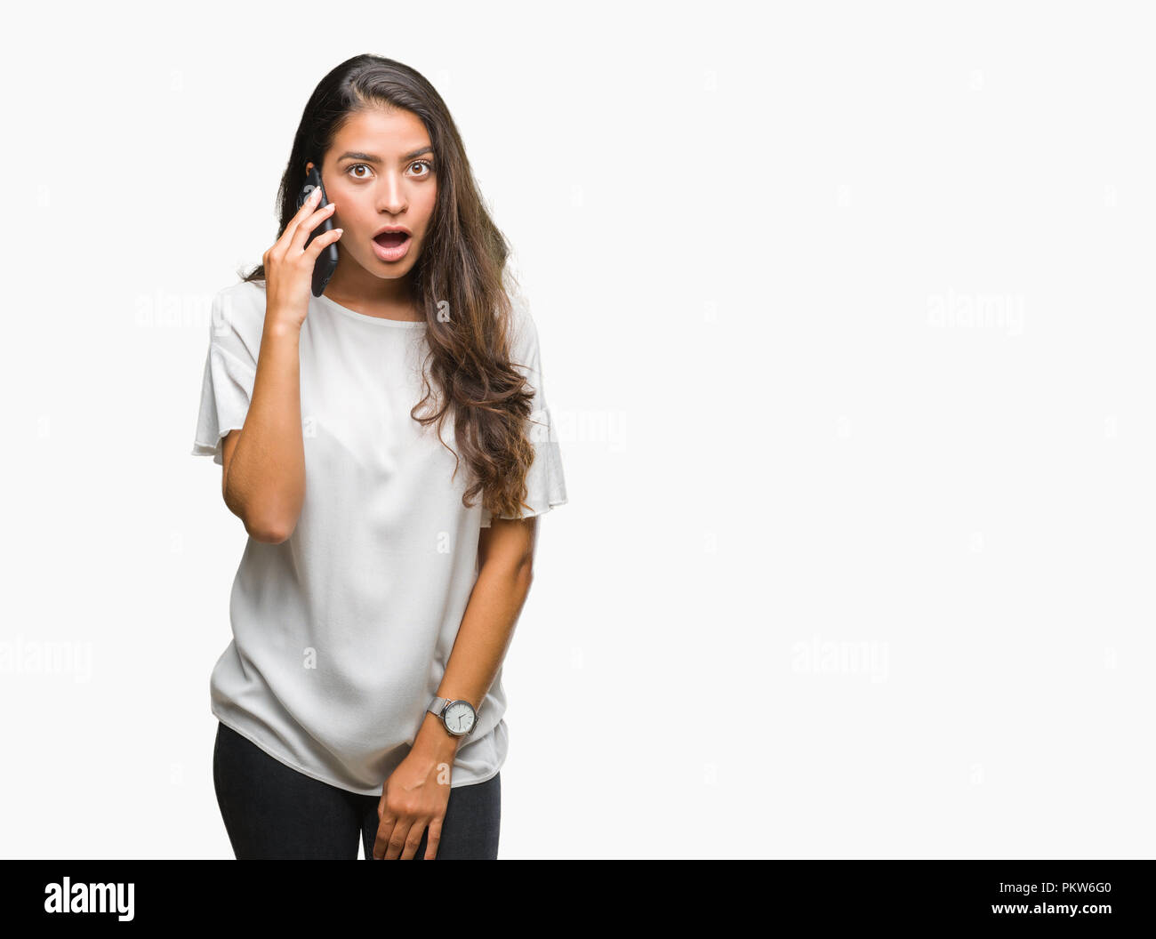 Young beautiful arab woman talking on the phone over isolated ...