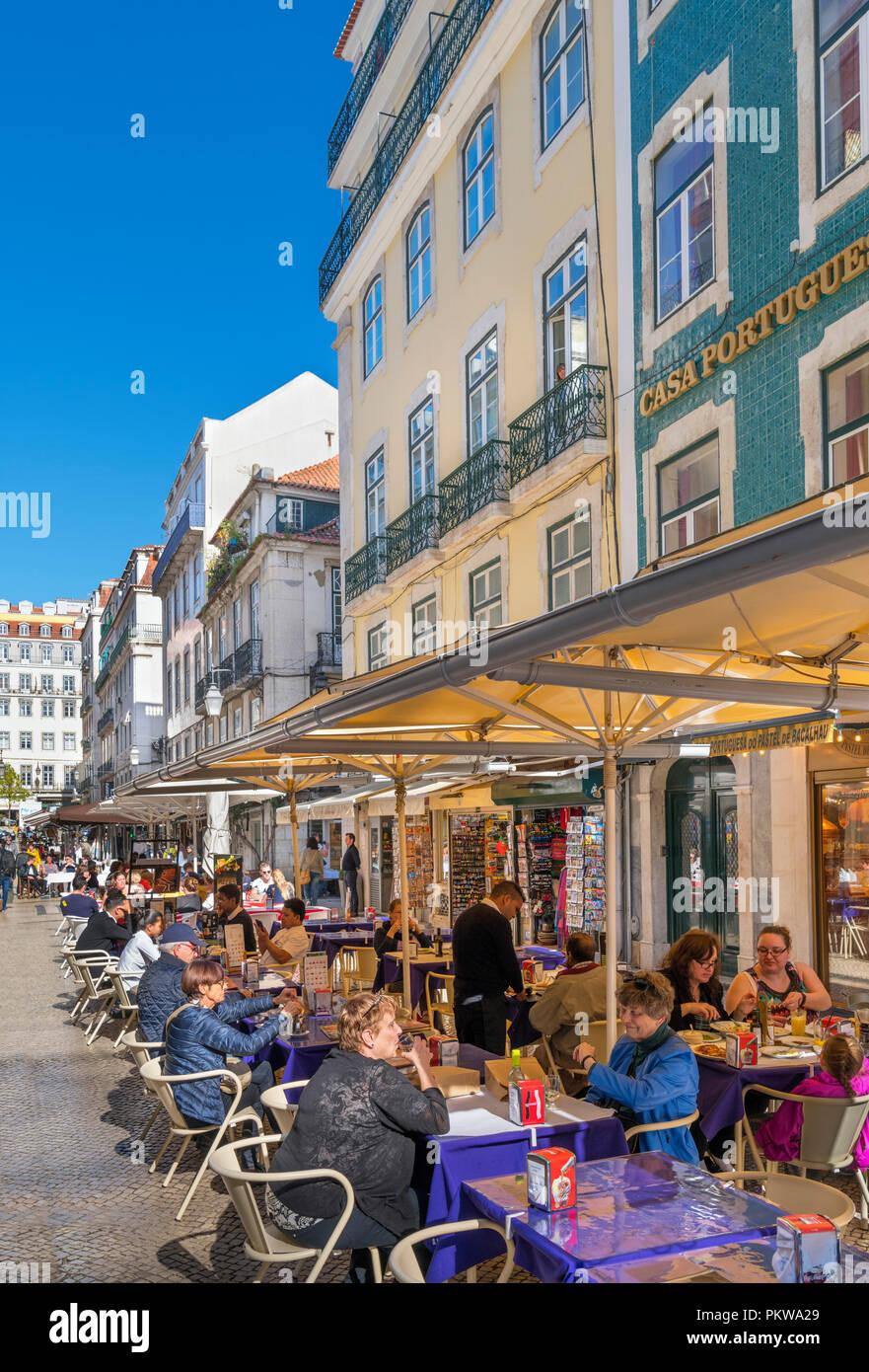 Cafes, bars, restaurants and shops on Rua da Augusta, Baixa district, Lisbon, Portugal - Stock Image