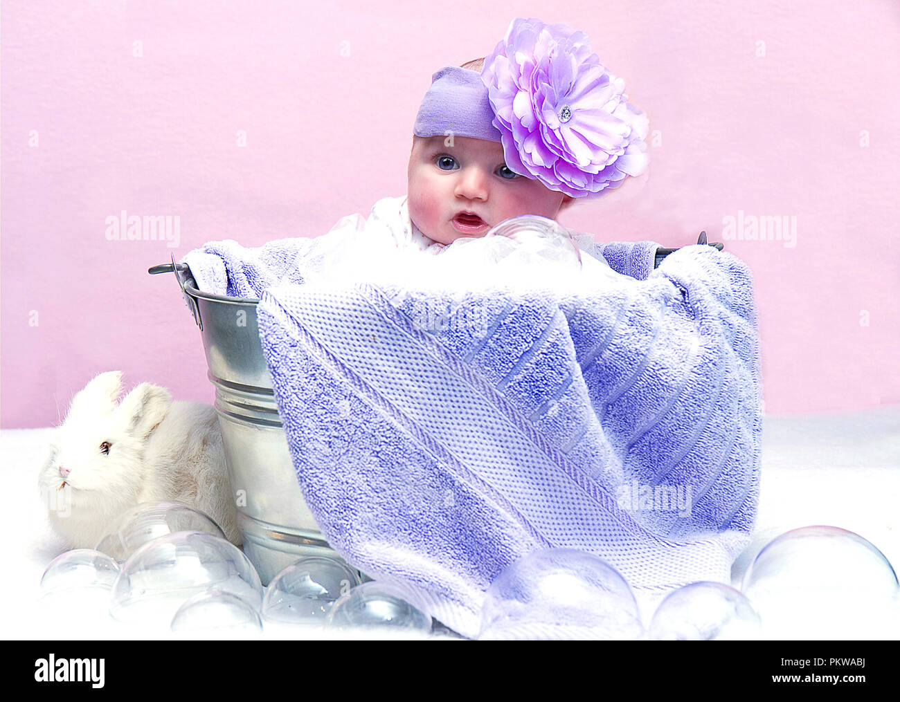 Baby girl assortment of images including wearing santa hat, sleeping, wash tub, crying, head flower band  and angelic wings. - Stock Image