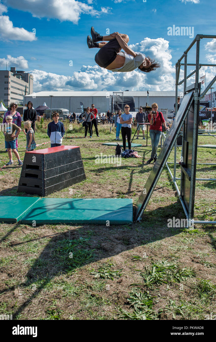 Rotterdam,Holland,15-sept-2018:Boy during pow wow festival doing a free run salto,POW! WOW!Festival is the best known street art festival in the world. And now its in Rotterdam - Stock Image