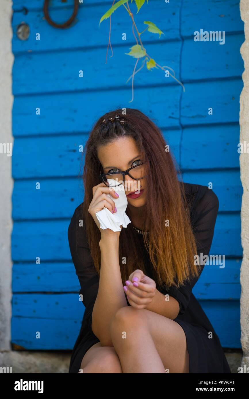 Young woman crying bad mood and sad - Stock Image