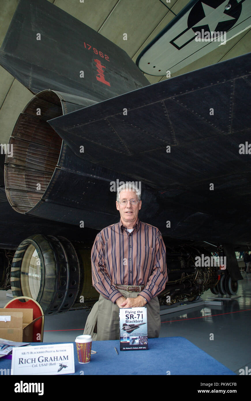 Rich Graham pilot of Lockheed SR-71 Blackbird spyplane jet, behind him. Colonel Richard Graham USAF United States Air Force. Book author on SR-71 - Stock Image