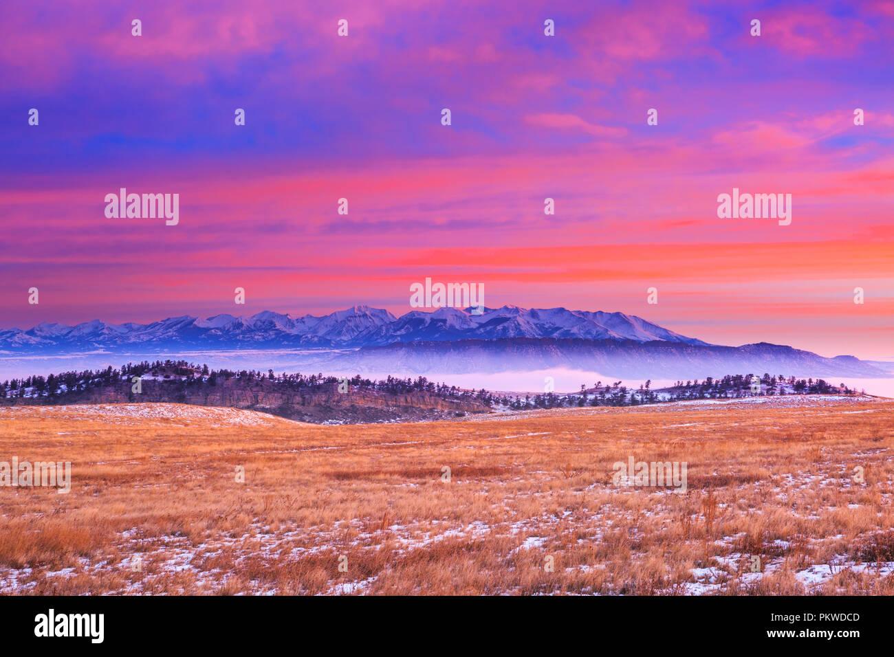 sunrise sky over the crazy mountains and sheep mountain near livingston, montana - Stock Image